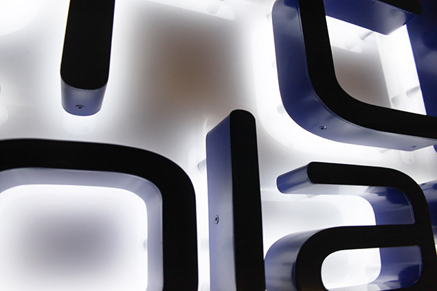 A close up view of the back-lit letters on a Faerch Plast monolith sign