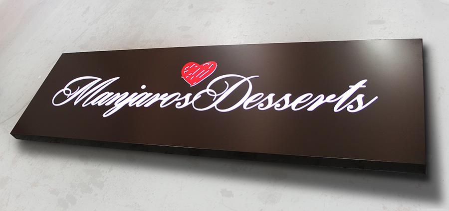 An image showcasing the entire Manjaros Desserts Sign