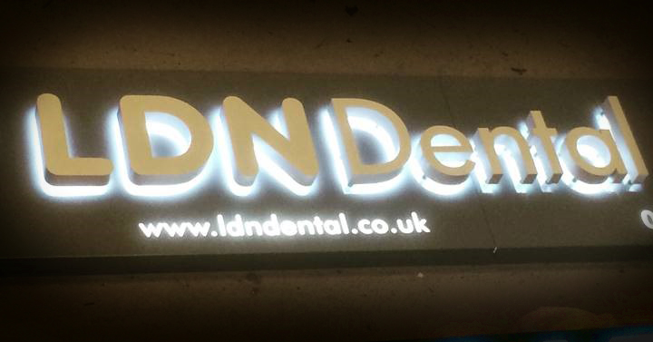 A LDN Dental sign with back-lit letters and their contact information