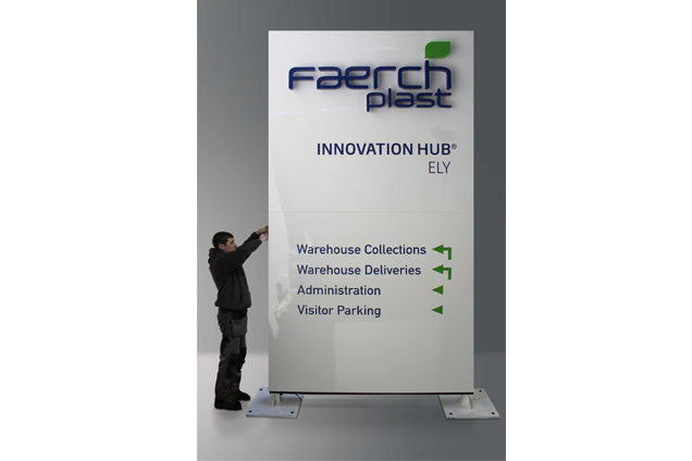 A Faerch Plast monolith sign featuring their logo and directions around their building